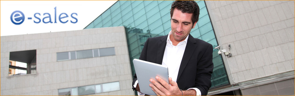 Man using electronic tablet in front of modern building